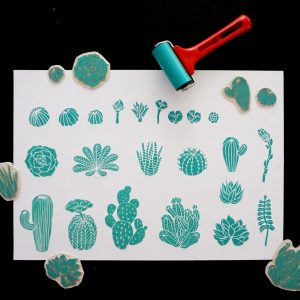 linocut print tests with the new stamp and lovely light green colors